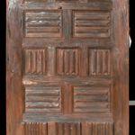 Custom front door made with antique carved door