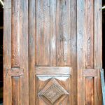 Custom front door made with antique door and salvaged lumber