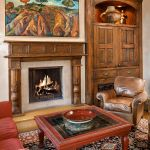 Fireplace mantel with surround and media cabinet
