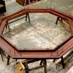 Octagonal suspended shelves in custom built bars