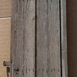 Antique planks used to make arched door