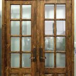 Custom French doors with transom and carved panels