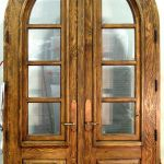 Arched French doors with operable shutters