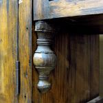 Finial from antique dowry chest used in kitchen cabinet detail