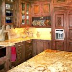 Carved wood refrigerator panels and cabinets