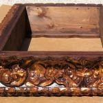 Side detail of gold leaf stove hood