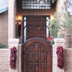 Arched entry gate and custom door