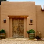 Antique Mexican gates with heavy timber header