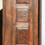 door with carved panels