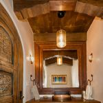 powder room door and beams and corbels