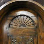 Detail of arched carved antique panel