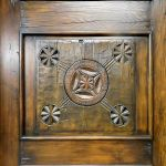 Antique carved panel with closed peep window