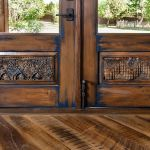 Antique carved panel detail on French doors